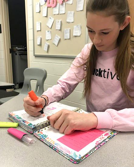Bailey Elliot is using her study time wisely. A calendar helps Elliot keep track of tests and homework.
