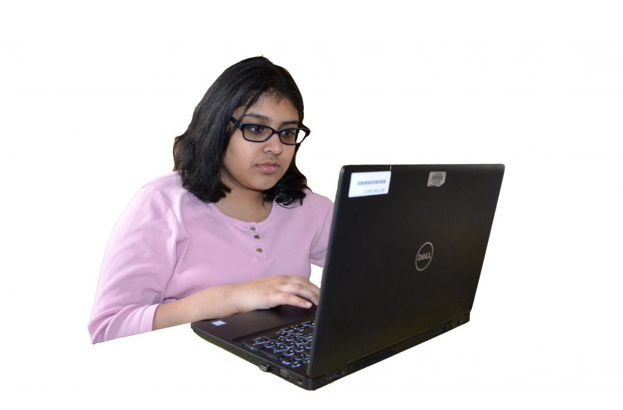 Freshman+Anika+Akkapeddi+works+on+submitting+an+assignment+online.+Virtual+Loudoun%E2%80%99s+classes+are+all+online+and+accessible+as+long+as+internet+is+available.+
