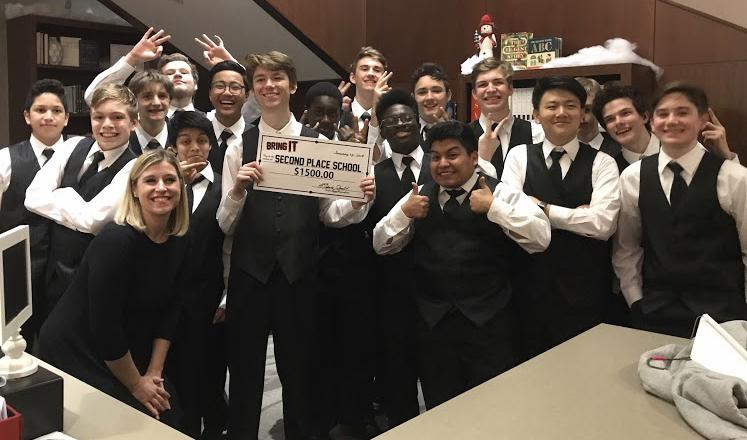 Laura Lazarevich, FHS' choir director, and Men's Chorus celebrate after winning second place at the BRING IT! competition.
