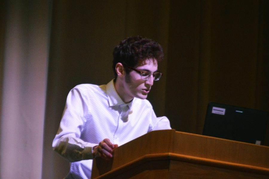 Ashkaan Kashani, senior, introduces his topic about the hyperreal.