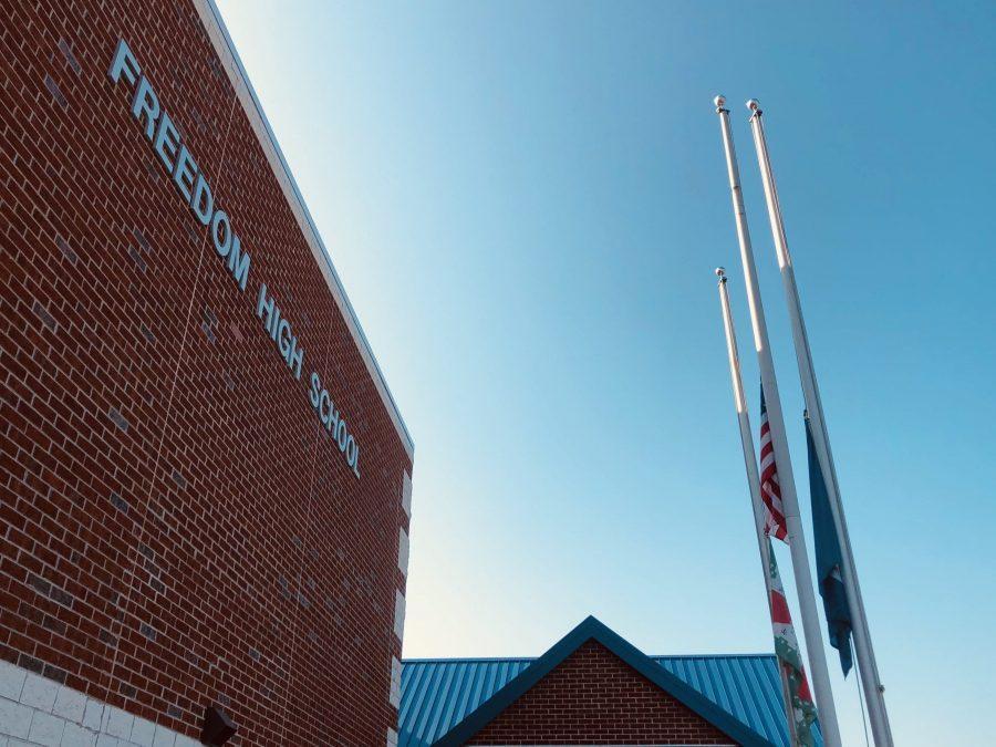 Freedom+flags+raised+at+half+mast.+