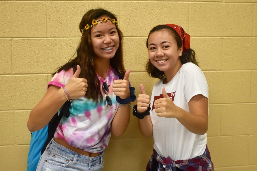 Juniors Maddie Do and Hannah Tenorio dress in 70s and 90s attire to show their school spirit.