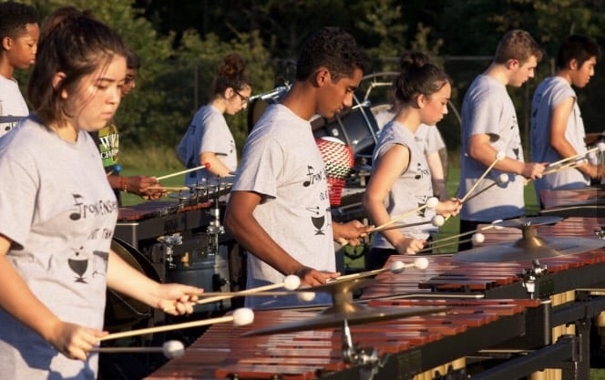 Members+of+marching+band+play+xylophones+during+practice+on+the+baseball+field.+Photo+by+Scott+Philben