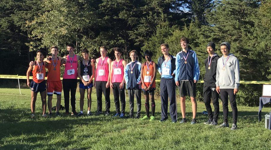 Top 12 boy runners from the 5A district line up to snap a photo with their new medals.
