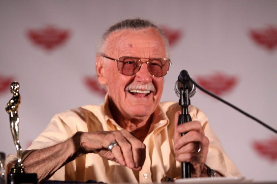 Stan Lee at a convention panel, laughing long with fans