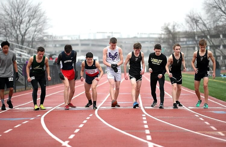 Photo+by+Chong+Chung.%0ASophomores%2C+Josh+Facey%2C+Ryan+Borden%2C+and+Cole+Edwards+get+into+starting+position+for+the+1600m+race%2C+as+they+wait+for+the+gun+shot+to+announce+the+start+of+their+race+at+the+David+Cannon+Memorial+Polar+Bear+meet+on+December+1st%2C+2018.