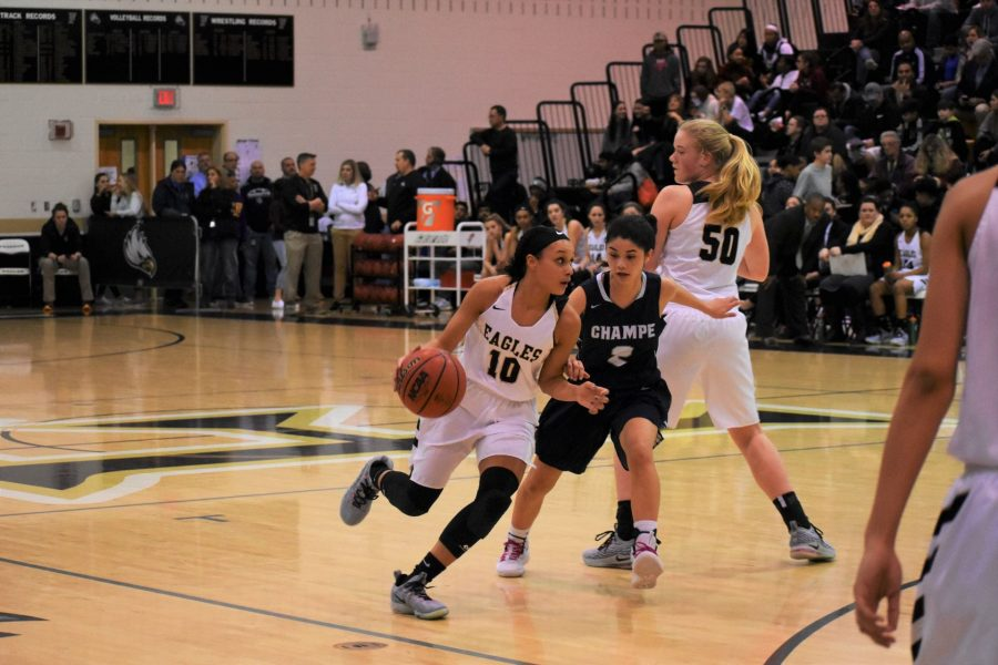 Kamryn Meador drives to the basket at the Champe vs. Freedom Gold Rush game.
