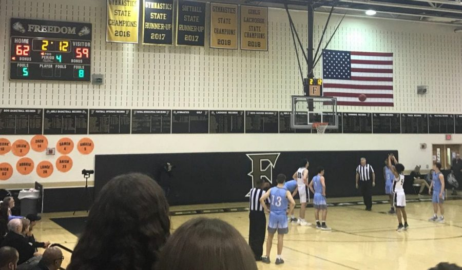 Boys Varsity plays a challenging game against Stone Bridge.