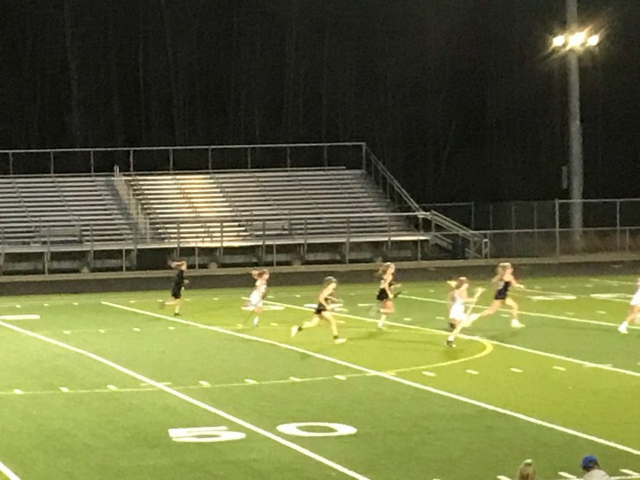 Bring the ball down the field, junior Emily Maier, takes it down and scores a goal for freedom.
