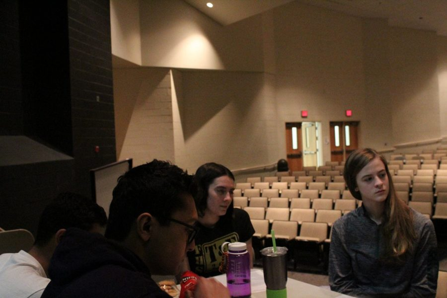 Seniors+Madison+Boyer+and+Doria+Smith+listen+as+other+students+discuss+how+religion+impacts+their+identity