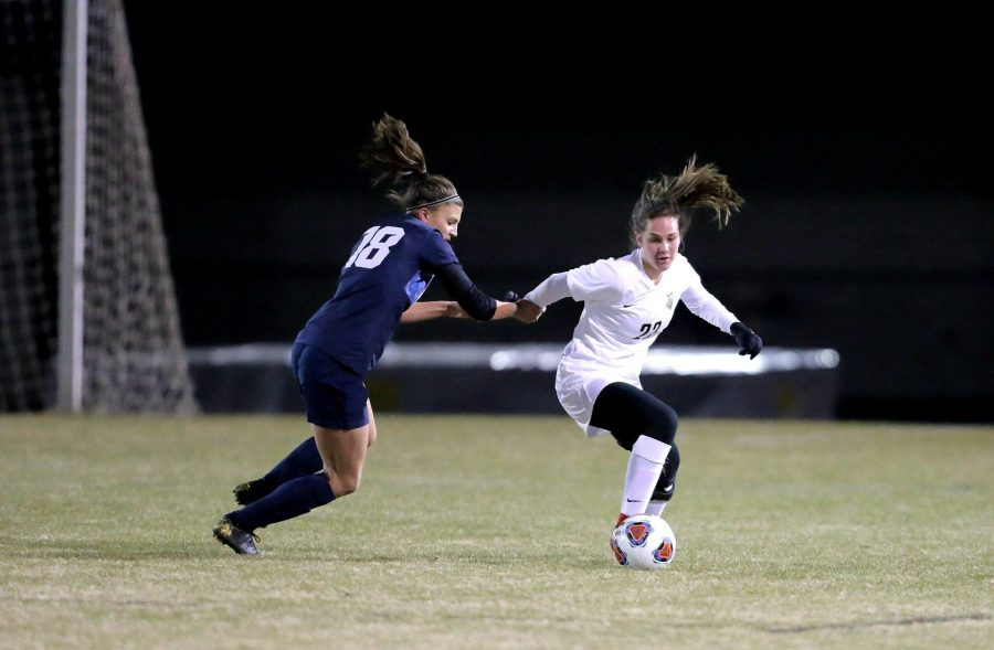 Photo+provided+by+Chong+Chung%0A%0ASenior+Annalise+Bickley+takes++the+ball+away+from+her+opponent+when+playing+Liberty+High+School.+