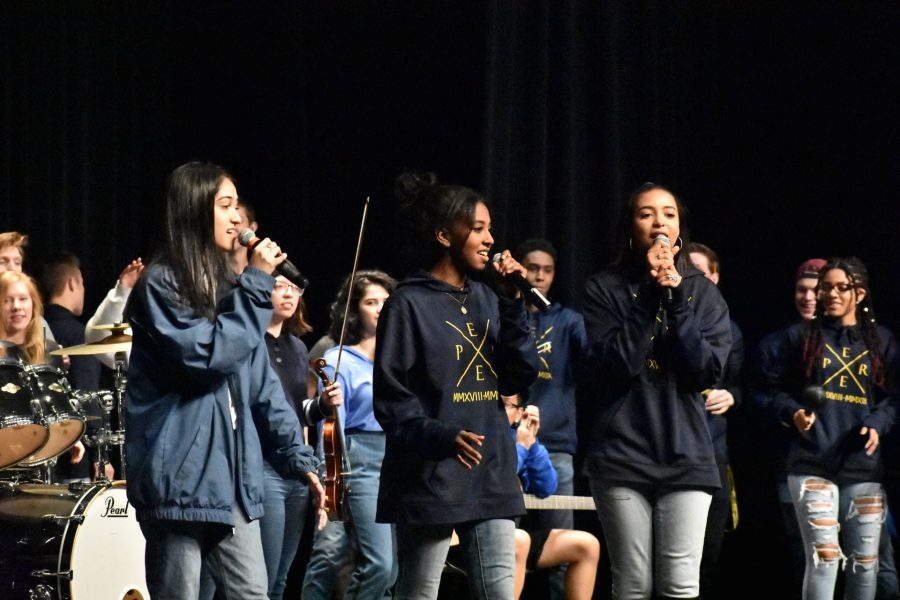 Hadia Moosvi, Wafa Humeida and Carolani Bartell close Hero in the Hallway with their rendition of One Step at a Time.  Feature image by: Lauren Balser
