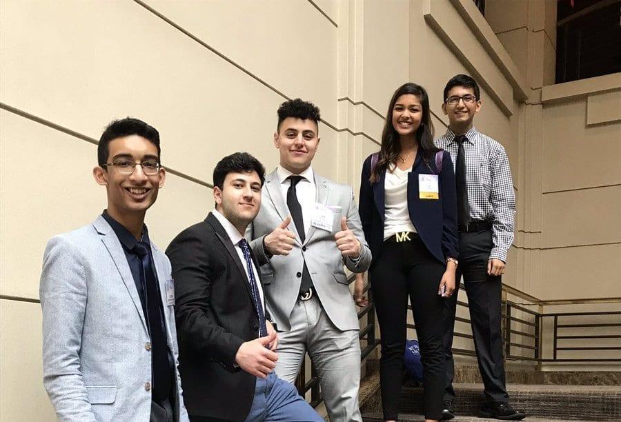 FBLA members Govind Molakalapalli, Steven Yousef, Sam Ramadan, Lin Sahu and Nalin Aggarwal pose for a picture Friday night