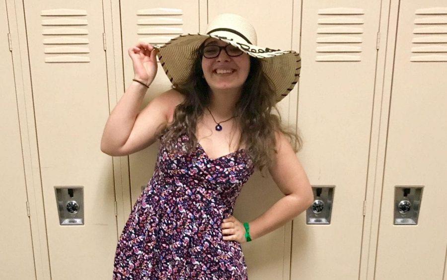 Sophomore Claire Jarwa goes all out with her floral dress and flouncy hat for Derby Day.