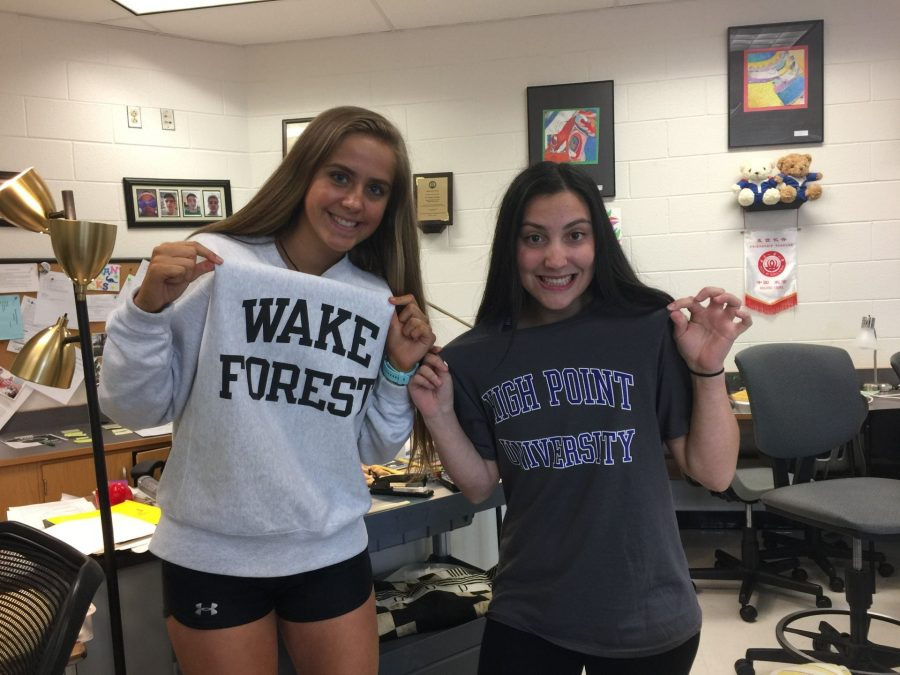 Juniors Julia Riley and Grace Catello getting into the spirit of prom week by wearing college gear