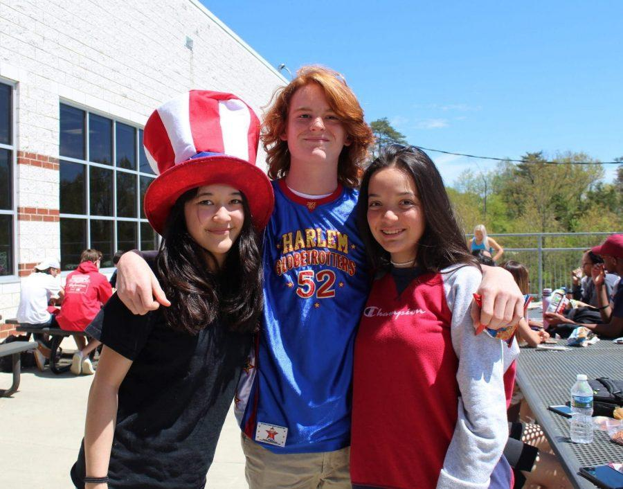 Senior+Mia+Brody+wears+an+American+themed+top+hat+while+junior+Cara+Macatuno+and+sophomore+Ty+Carter+pose+beside+her%2C+sporting+their+American+themed+spirit++
