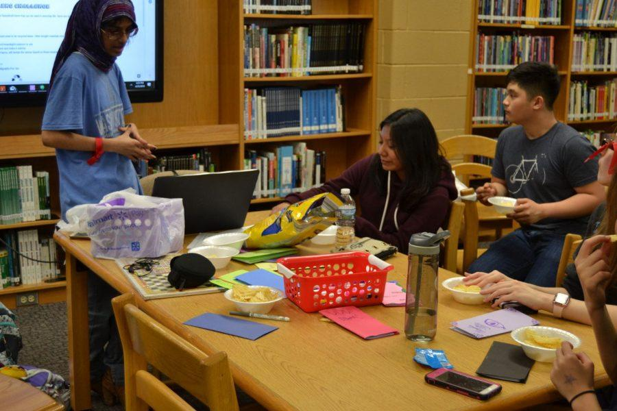 Sophomore+Azka+Tahir+briefing+the+group+about+their+new+recycling+project.