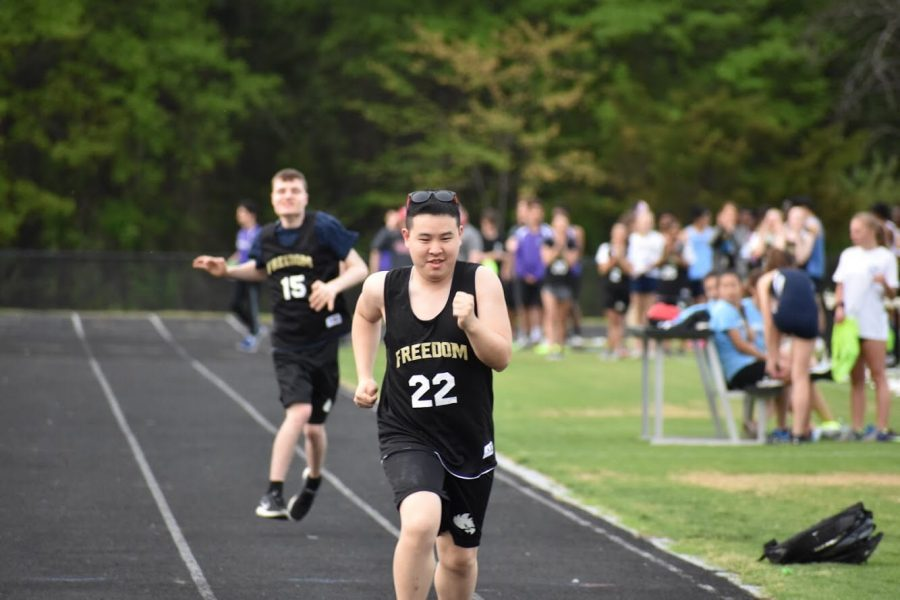Unified+athlete+Quinn+Tang+takes+the+lead+in+the+100+meter+dash.