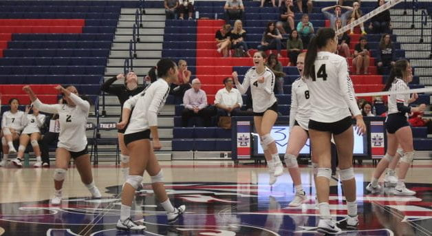 Freedoms+Varsity+Volleyball+team+leaps+for+joy+after+winning+the+game+against+Independence.+