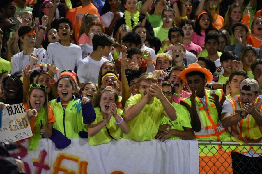 The+student+section%2C+all+wearing+their+brightest+neon+outfits%2C+cheer+for+the+Eagles+at+the+homecoming+game.+Photo+by+Ava+Proehl