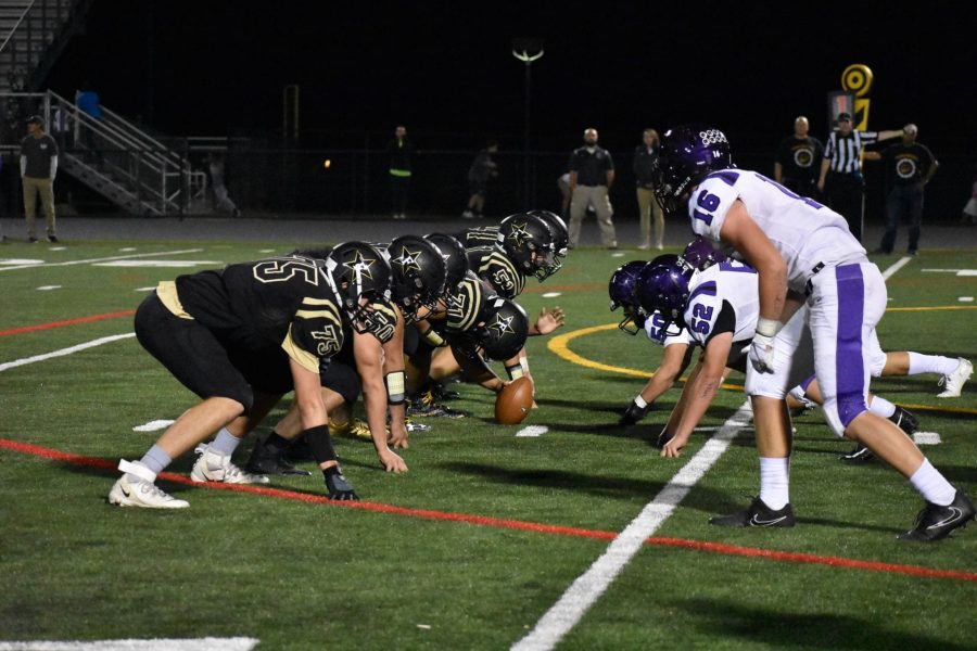 The Freedom Eagles offense sets up for a play against the Potomac Falls Panthers.