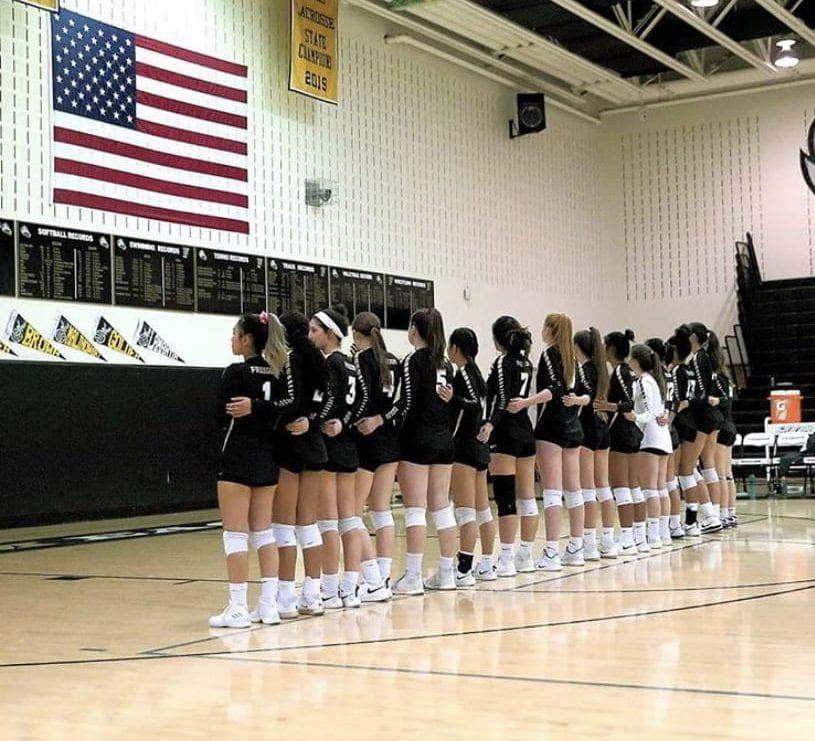 The Freedom High School Volleyball team listens to the National Anthem before playing their game against Rock Ridge on October 17th. (photo taken by Chong Chung)
