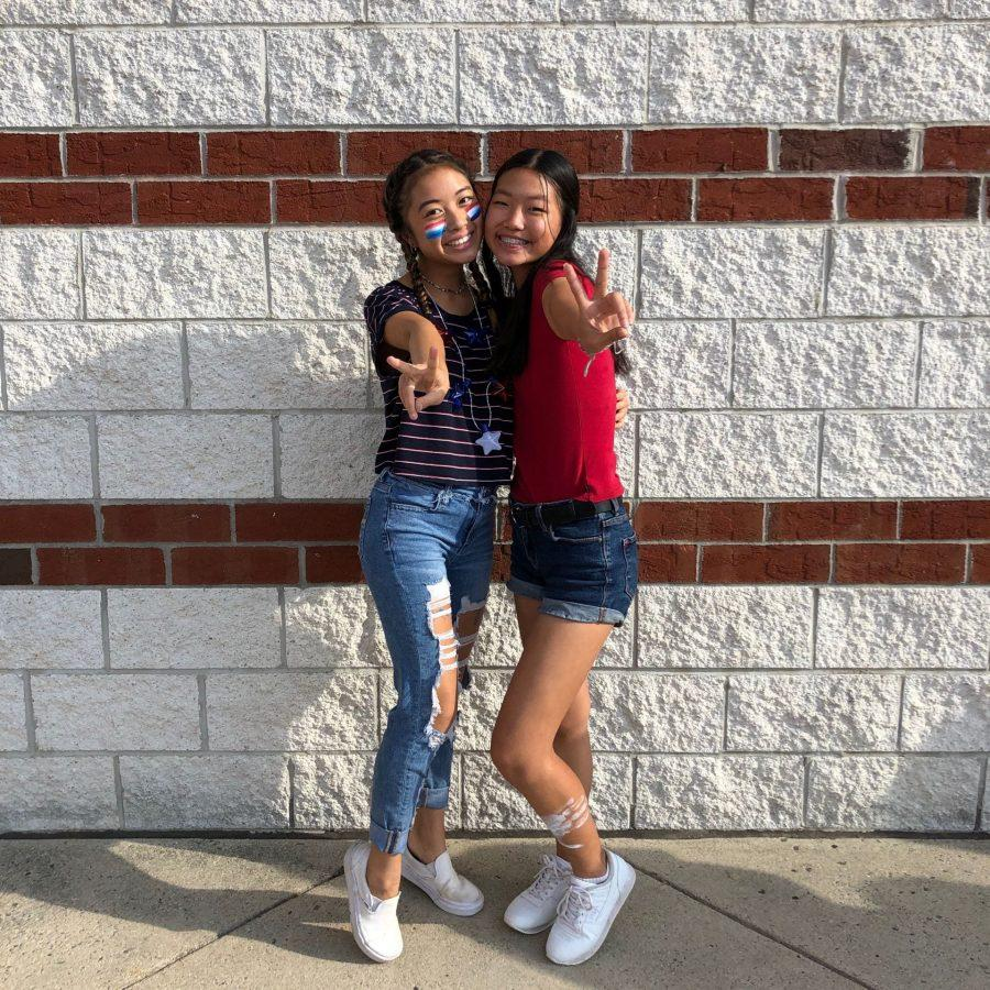 Sophomores+Jessica+Nguyen+and+Nara+Lee+wears+light-up+stars+with+paint+on+face+and+legs+on+U.S.A.+day.+Photo+taken+by+Lauriane+Razafinjatovo.
