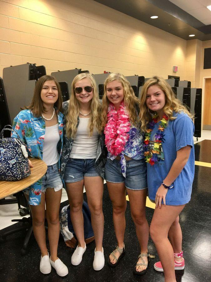 Photos by Aayusha Khanal Juniors, Grace Schofield, Carina Funk, Morgan Maiden, and Abby Doyle rep their trop out looks before the start of the school day.