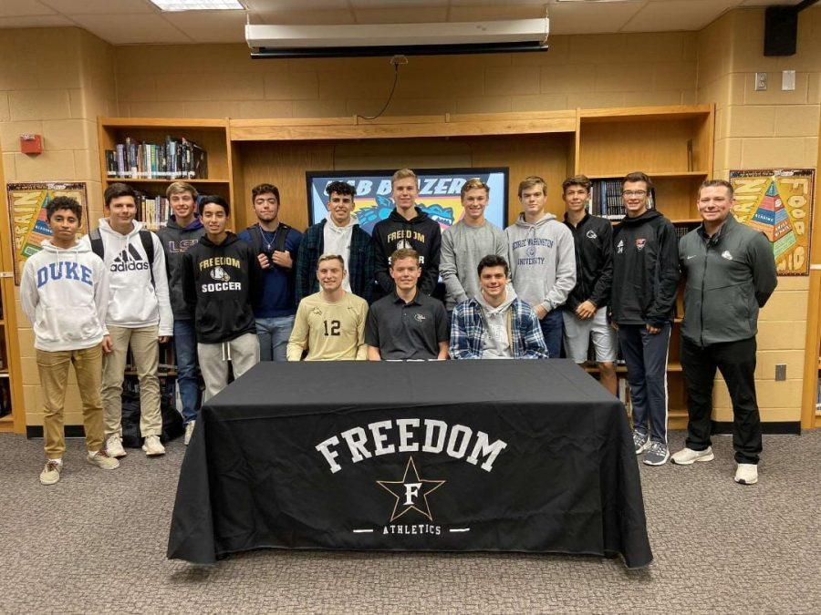 Freedom High Schools Soccer team supporting Andrew Strait (middle) at his college soccer signing. (Photo provided by Cole Edwards)