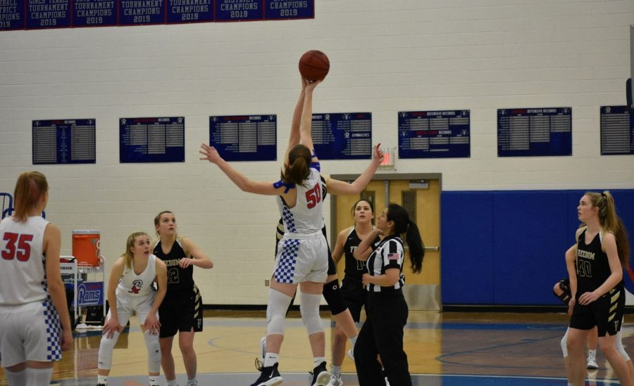 Brenna+Haley+leaps+for+the+jump+ball+to+start+the+game+against+Riverside.