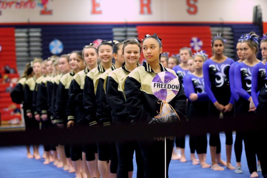 Photos Provided by Chong Chung  The FHS gymnastics team lines up before bringing home their third consecutive state title.