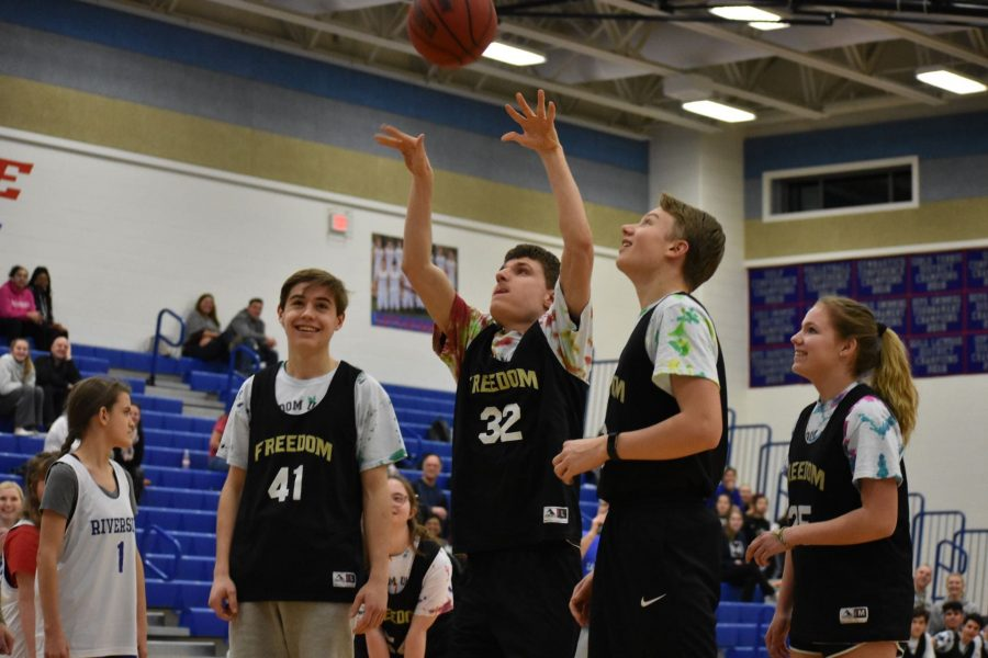 FHS Unified Basketball shoots one of the many baskets of the night. Photo by: Ava Proehl