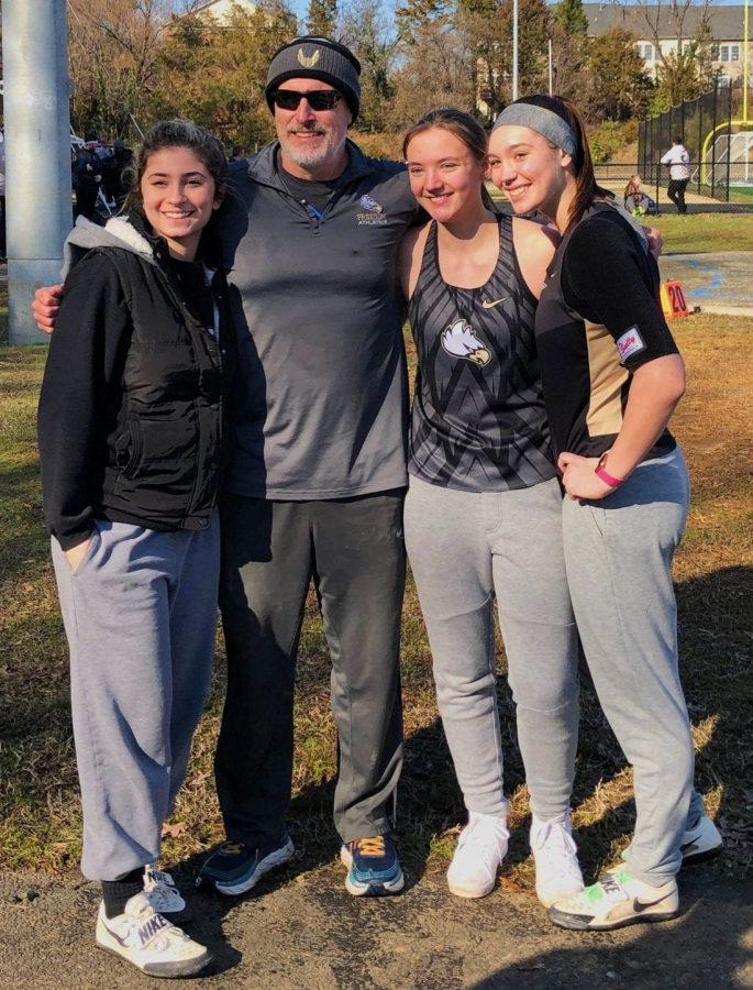 Freedom+High+School+throwers+Celine+Sayegh%2C+Morgan+Glass%2C+and+Chloe+Shepard+pose+with+their+coach+at+the+regional+Track+and+Field+meet.