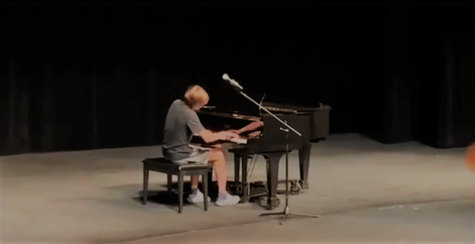 Hakon Grant playing piano at Governors School in Radford University.  Photo provided by Hakon Grant.