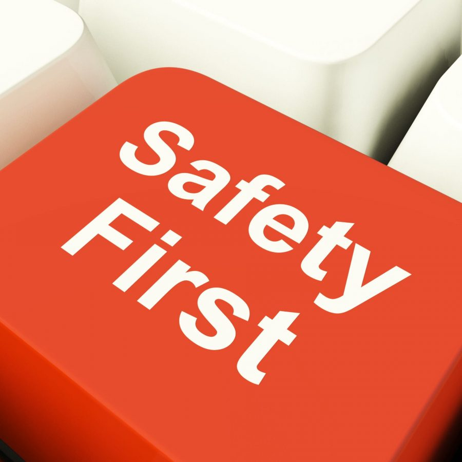 Photo Provided by VectorVest.com Safety First Computer Key Showing Caution Protection Or Hazards