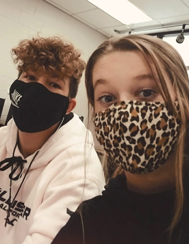 Photo provided by Alexis Hatmaker  Alexis and Kaden Hatmaker attend class wearing mask in Tennessee.