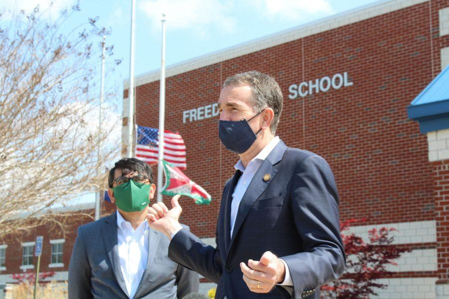Governor Ralph Northam and Virginia Secretary of State Atif Qarni respond to questions after their visit to Freedom High School. Photo by Michael Baker III.