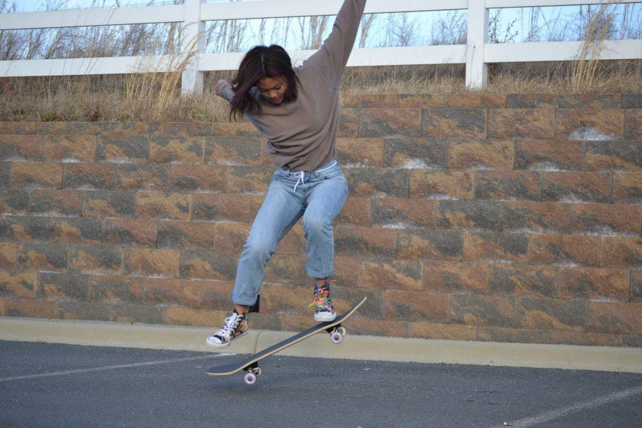 Freedom Senior Samantha Tiong practices a trick on her skateboard. Photo by Karen Xu.