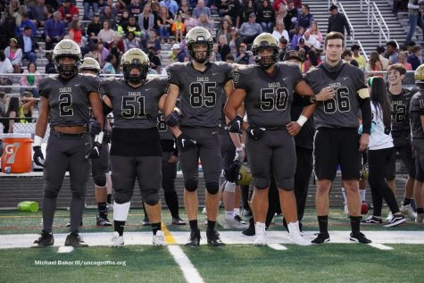 Captains (L-R) Jay Gary, Bryan Guzman, Cole Reemsnyder, Brandon Wilson and Caspian Bell walk out for the coin toss during the Homecoming game against Battlefield on Friday, Oct. 1. Photo by Michael Baker III.