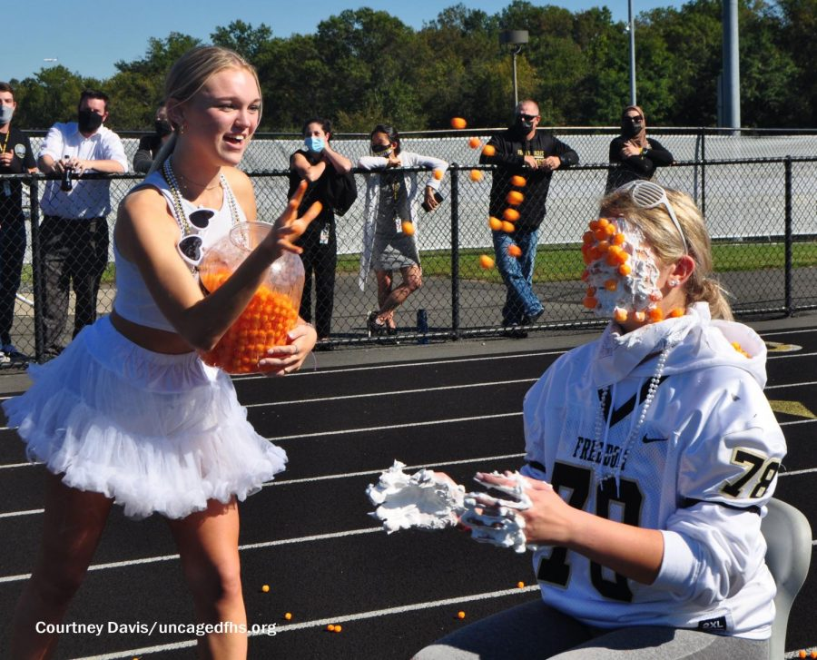 Sophomores Jenna Michaels and Emily Knowles participate in a game during the Homecoming pep rally.
